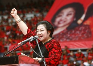 Former President Megawati Sukarnoputri and chairperson of the Indonesian Democratic Party speaks to her supporters during a rally in Jakarta